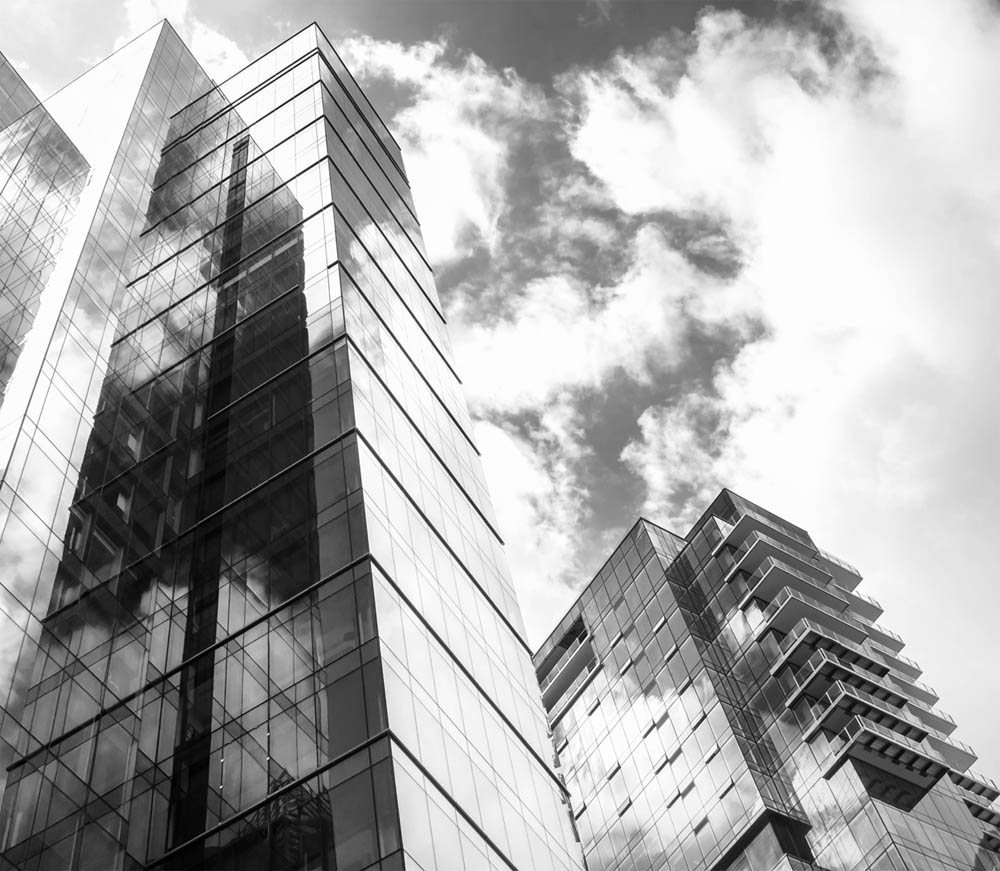 Modern Glass and Steel Buildings Reflecting the Sky